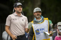 Corey Conners, of Canada, plans his shot with his caddie Danny Sahl, right, the ninth tee during the second round of the RBC Heritage golf tournament in Hilton Head Island, S.C., Friday, April 16, 2021. (AP Photo/Stephen B. Morton)