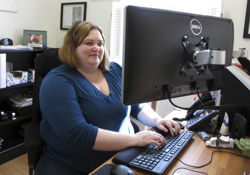 In this May 15, 2019, photo, Beth Dow, a commercial property adjuster, works from home in Bennington, Vt. She and her husband recently moved to Vermont from Colorado through a Vermont program to attract new residents. (AP Photo/Lisa Rathke)