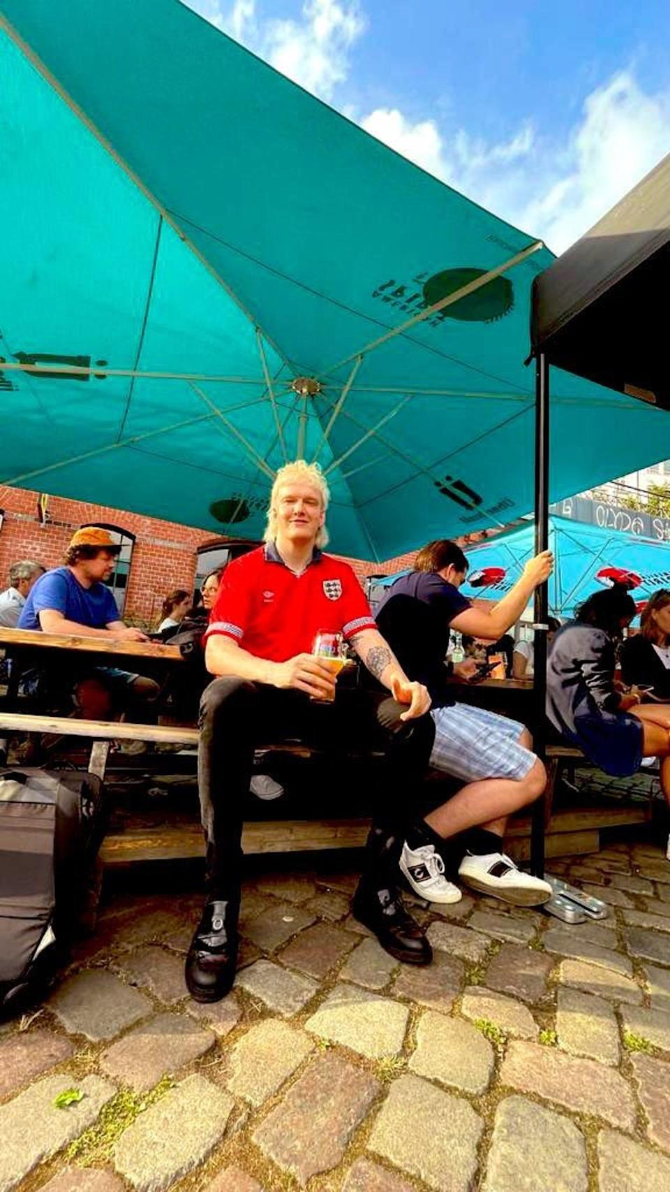 Joel Phillips watches the England v Germany game in a Hamburg pub