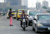 Cars drive along a road in Lagos