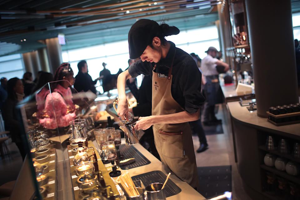 CHICAGO, ILLINOIS - NOVEMBER 12: A worker prepares drinks during a media preview at Starbucks Reserve Roastery on November 12, 2019 in Chicago, Illinois. With 35,000 square feet over four floors and a rooftop deck, the restaurant, which opens to the public on November 15, will be the company's largest. The restaurant features a cocktail bar, a reserve coffee bar, and experimental coffee bar and a bakery and cafe, each on separate levels.  (Photo by Scott Olson/Getty Images)