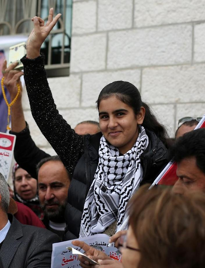 Malak al-Khatib, a 14-year old Palestinian schoolgirl jailed in an Israeli prison for six week, is seen at a rally calling for the release of Palestinian minors from Israeli jails (AFP Photo/Abbas Momani)