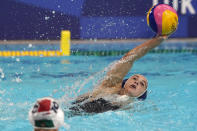 United States' Margaret Steffens reaches for the ball during a preliminary round women's water polo match against South Africa at the 2020 Summer Olympics, Wednesday, July 28, 2021, in Tokyo, Japan. (AP Photo/Mark Humphrey)