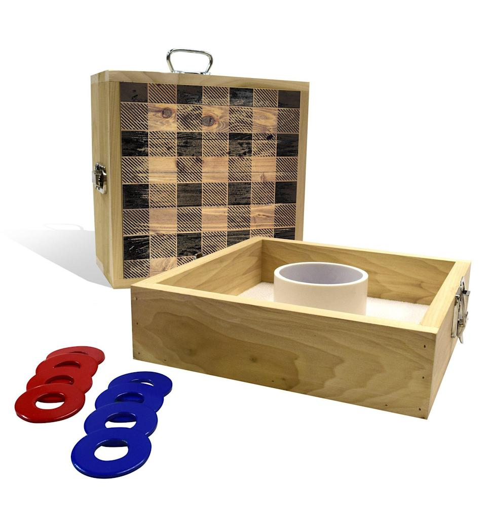 """<p>slickwoodys.com</p><p><strong>$65.00</strong></p><p><a href=""""https://www.slickwoodys.com/collections/tailgate/products/country-living-black-checker-pattern-washer-toss-game"""" rel=""""nofollow noopener"""" target=""""_blank"""" data-ylk=""""slk:Shop Now"""" class=""""link rapid-noclick-resp"""">Shop Now</a></p><p>Let your grandpa's competitive spirit shine with this backyard washer toss lawn game that packs up into a portable box.</p>"""