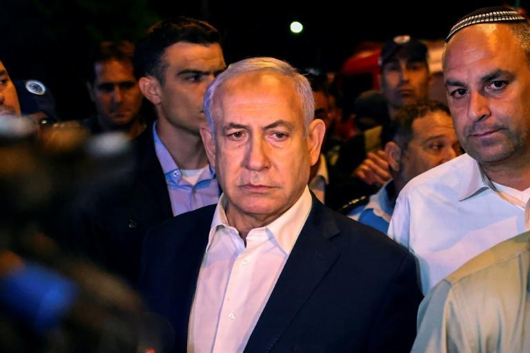 Israeli Prime Minister Benjamin Netanyahu tours the city of Lod early on May 12