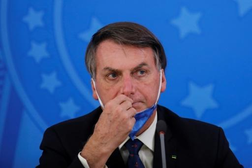 """Brazil's President Jair Bolsonaro insists the coronavirus is just a """"little flu"""" and opposed the self-isolation measures now observed by half the wold's population"""