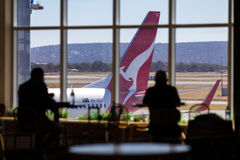 A general view of Perth domestic airport where a Qantas plane is seen out the window.