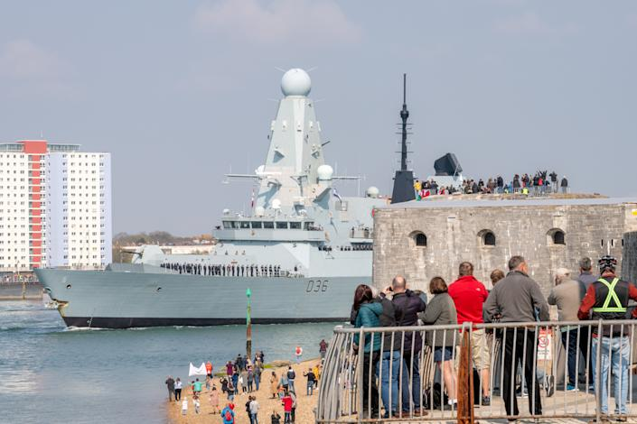 HMS Defender is joining the HMS Queen Elizabeth as the UK Carrier Strike Group sets sail. (SWNS)