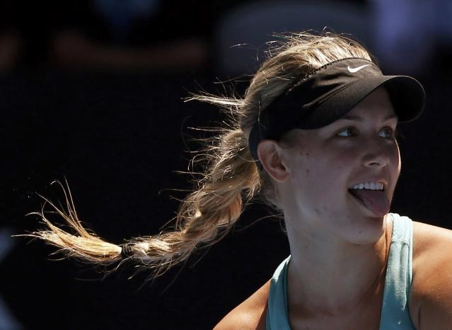 Eugenie Bouchard of Canada reacts during her women's quarter-final tennis match against Ana Ivanovic of Serbia at the Australian Open 2014 tennis tournament in Melbourne January 21, 2014. REUTERS/Jason Reed (AUSTRALIA - Tags: SPORT TENNIS TPX IMAGES OF THE DAY)