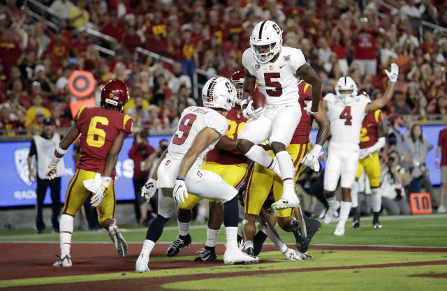 Stanford wide receiver Connor Wedington (5) leaps in the end zone after a touchdown catch against Southern California during the first half of an NCAA college football game Saturday, Sept. 7, 2019, in Los Angeles. (AP Photo/Marcio Jose Sanchez)
