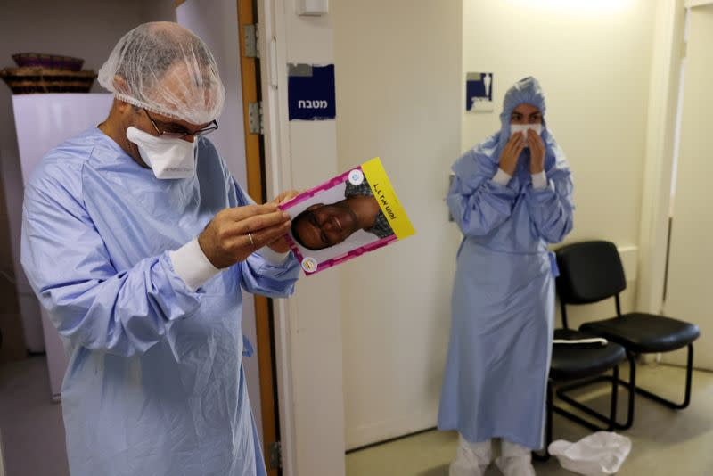 Doctor Guy Choshen, director of the COVID-19 ward in Ichilov Hospital, gets ready to enter the ward in Tel Aviv