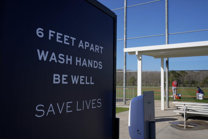 Signs are posted during a Boston Red Sox spring training baseball practice on Monday, Feb. 22, 2021, in Fort Myers, Fla. (AP Photo/Brynn Anderson)