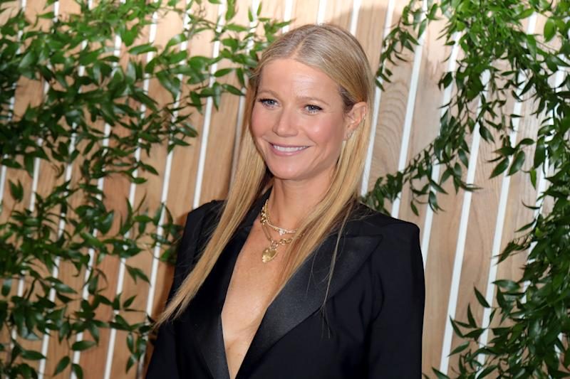 Gwyneth Paltrow in black outfit, hair down and straight.