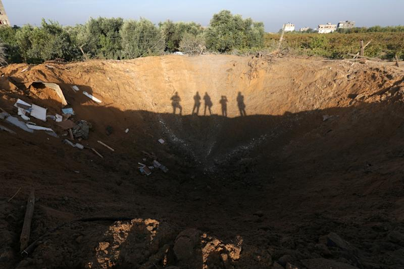 The crater left by an Israeli retaliatory air strike that demolished the house of a Palestinian family in the Zeitun sector south of Gaza City on October 11, 2015 (AFP Photo/Mahmud Hams)