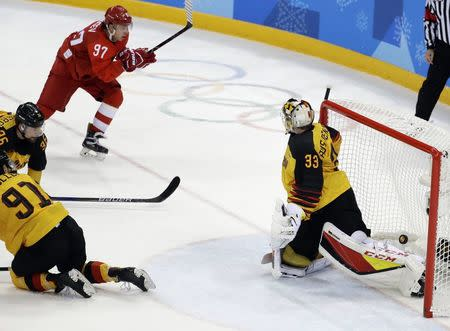 Ice Hockey - Pyeongchang 2018 Winter Olympics - Men Final Match - Olympic Athletes from Russia v Germany - Gangneung Hockey Centre, Gangneung, South Korea - February 25, 2018 - Olympic Athlete from Russia Nikita Gusev scores. REUTERS/David W Cerny