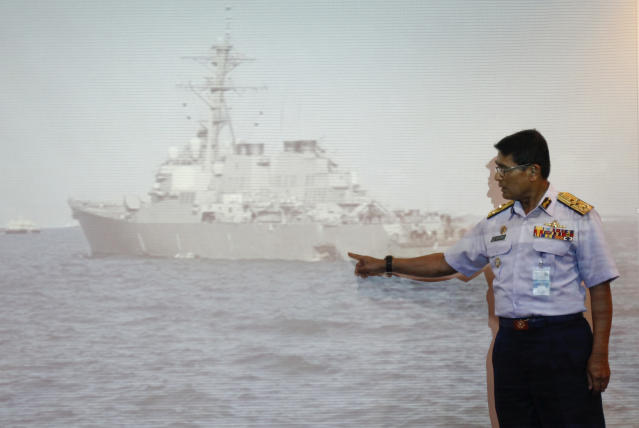 "<p>Malaysian Maritime Director Indera Abu Bakar points the damage of USS John S. McCain shown on a screen during a press conference in Putrajaya, Malaysia, Aug. 21, 2017. The U.S. Navy said the USS John S. McCain arrived at Singapore's naval base with ""significant damage"" to its hull after a collision early Monday between it and an oil tanker east of Singapore. A number of U.S. sailors are missing after the collision, the second accident involving a ship from the Navy's 7th Fleet in the Pacific in two months. (Photo: Daniel Chan/AP) </p>"