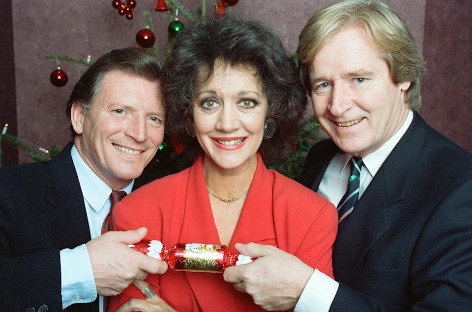 'Coronation Street' stars Johnny Briggs (Mike Baldwin), Amanda Barrie (Alma Baldwin) and William Roache (Ken Barlow), pictured in December 1991. (Photo by Nigel Wright/Mirrorpix/Getty Images)