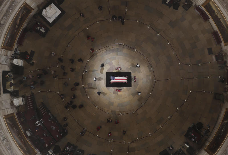 Members of the public are seen inside the Capitol Rotunda as former President George H.W. Bush lies in state on Wednesday ahead of his memorial service.  (ASSOCIATED PRESS)