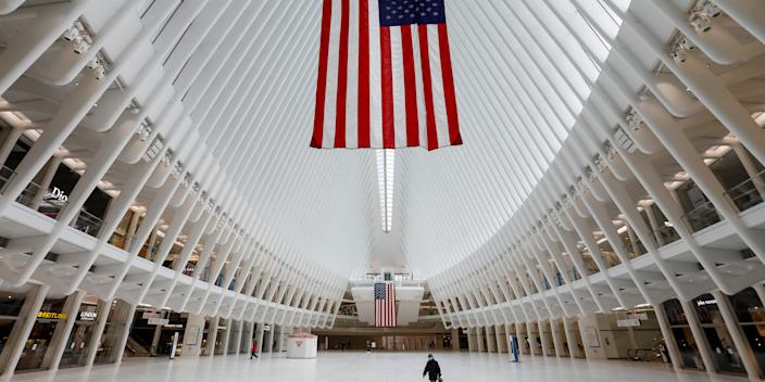 A man walks alone through the nearly empty Oculus transportation hub at the World Trade Center in lower Manhattan, during the outbreak of the coronavirus disease (COVID-19) in New York City, New York, U.S., April 20, 2020. REUTERS/Andrew Kelly