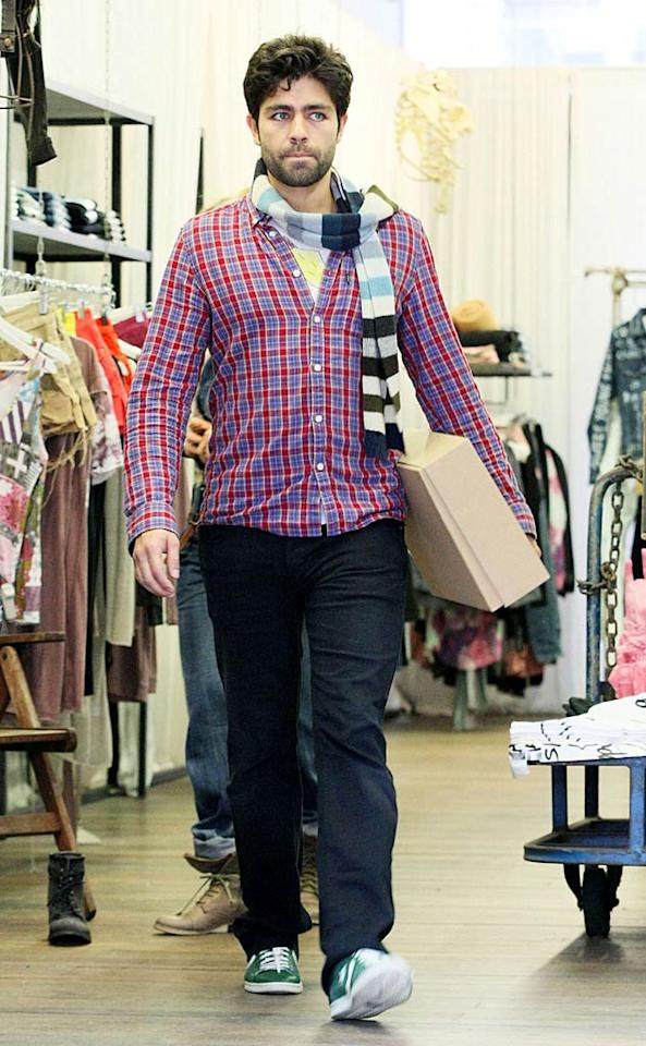 """Down Under, """"Entourage"""" star Adrian Grenier looked serious about his shopping in Sydney. Well, now that his HBO show has ended its eight-season run, the 35-year-old has plenty of time to circle the globe looking for wardrobe additions. (10/26/2011)"""