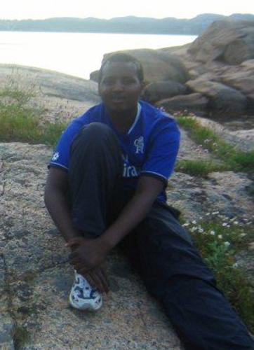 ADDS SOURCE INFORMATION AND PROVIDES ALTERNATE CROP - In this June 2007 photo provided by a former classmate, Norwegian-Somali Hassan Abdi Dhuhulow sits on a rock during a school outing in Larvik, Norway. Dhuhulow has been identified as one of the gunmen who attacked an upscale mall in Kenya, officials said Friday Oct. 18, 2013. (AP Photo)