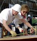 FILE - In this Aug. 6, 2001, file photo former U.S. President Jimmy Carter, left, and his wife Rosalynn help build a house for the Jimmy Carter Work Project 2001, at Asan near Chonan city, south of Seoul, South Korea. Jimmy Carter and his wife Rosalynn celebrate their 75th anniversary this week on Thursday, July 7, 2021. (AP Photo/Yun Jai-hyoung, File)