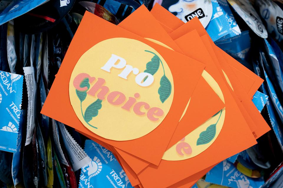 A pro-choice bumper sticker sits on a basket of condoms on campus at Saint Mary's College. (Photo: Evan Cobb for HuffPost)