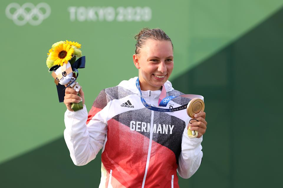 TOKYO, JAPAN - JULY 29: Bronze medalist Andrea Herzog of Team Germany celebrates at the medal ceremony following the Women's Canoe Slalom Final on day six of the Tokyo 2020 Olympic Games at Kasai Canoe Slalom Centre on July 29, 2021 in Tokyo, Japan. (Photo by Harry How/Getty Images)