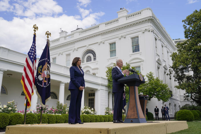 Vice President Kamala Harris listens as President Joe Biden speaks on updated guidance on face mask mandates and COVID-19 response, in the Rose Garden of the White House, Thursday, May 13, 2021, in Washington. (AP Photo/Evan Vucci)