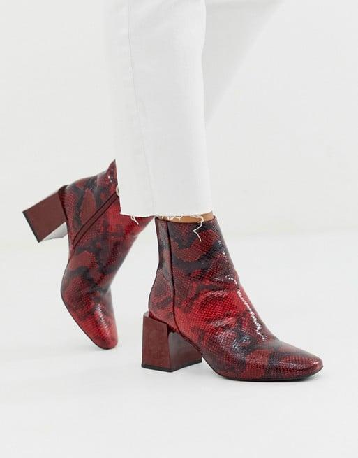 """<p>If you prefer more color, try out these <a href=""""https://www.popsugar.com/buy/ASOS-DESIGN-Reed-Heeled-Ankle-Boots-483834?p_name=ASOS%20DESIGN%20Reed-Heeled%20Ankle%20Boots&retailer=us.asos.com&pid=483834&price=48&evar1=fab%3Aus&evar9=46535091&evar98=https%3A%2F%2Fwww.popsugar.com%2Fphoto-gallery%2F46535091%2Fimage%2F46535249%2FASOS-DESIGN-Reed-Heeled-Ankle-Boots&list1=shopping%2Cfall%20fashion%2Cshoes%2Cboots%2Canimal%20print&prop13=api&pdata=1"""" rel=""""nofollow"""" data-shoppable-link=""""1"""" target=""""_blank"""" class=""""ga-track"""" data-ga-category=""""Related"""" data-ga-label=""""https://us.asos.com/asos-design/asos-design-reed-heeled-ankle-boots-in-red-snake/prd/12472981?clr=red-snake&amp;colourWayId=16428487&amp;SearchQuery=snake%20shoes%20women"""" data-ga-action=""""In-Line Links"""">ASOS DESIGN Reed-Heeled Ankle Boots </a> ($48).</p>"""