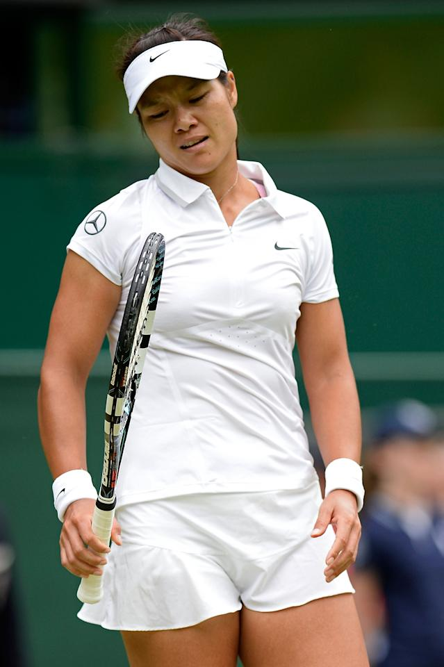 LONDON, ENGLAND - JULY 02: Na Li of China reacts during the Ladies' Singles quarter-final match against Agnieszka Radwanska of Poland on day eight of the Wimbledon Lawn Tennis Championships at the All England Lawn Tennis and Croquet Club at Wimbledon on July 2, 2013 in London, England. (Photo by Dennis Grombkowski/Getty Images)