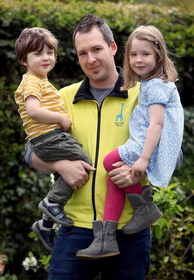 Dad-of-two Sam Mills, 38, pictured here with his own children Molly and Harry, spent years working as a luxury furniture designer producing high-end pieces for celebrities. [Photo: Caters]