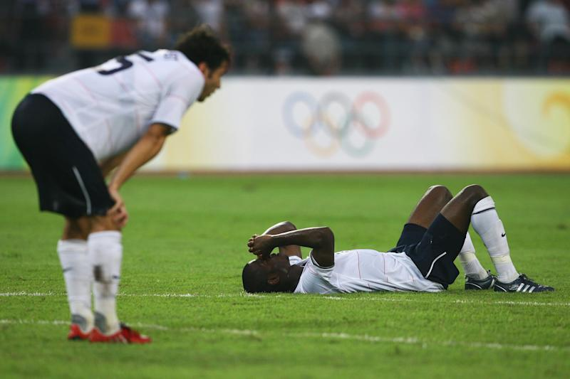 BEIJING - AUGUST 13: (L-R) Michael Parkhurst and Maurice Edu #6 of the United States react after losing to Nigeria 2-1 during the Men's First Round Group B match on Day 5 of the Beijing 2008 Olympic Games on August 13, 2008 in Beijing, China. (Photo by Shaun Botterill/Getty Images)
