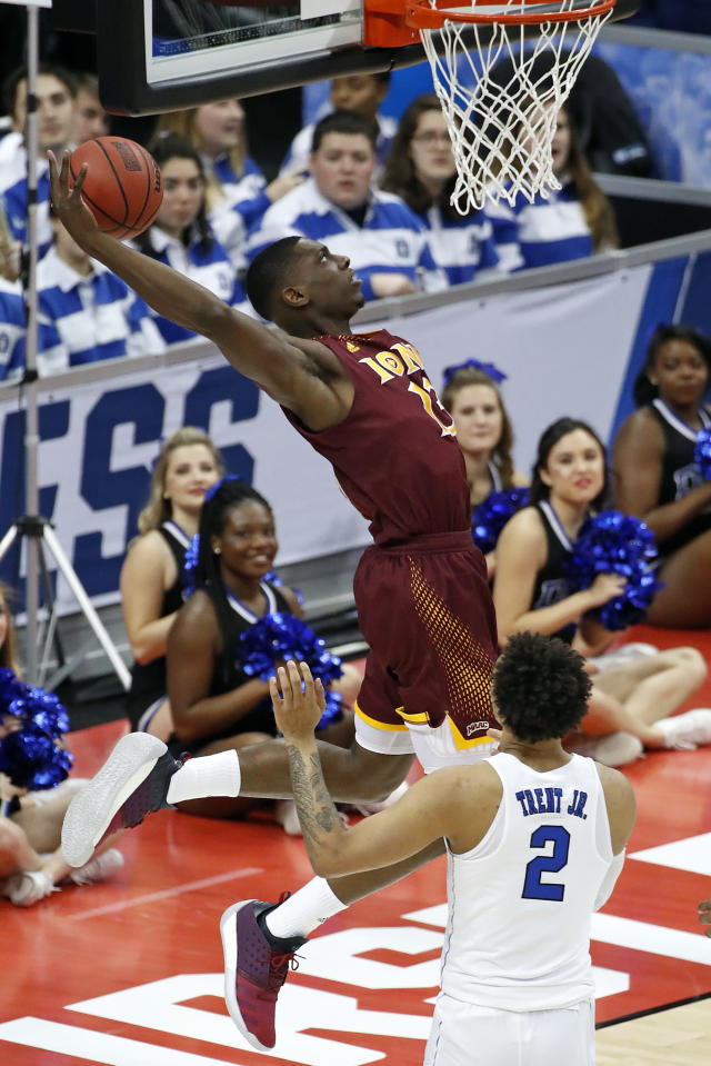 Iona's TK Edogi attempts a dunk during the first half of an NCAA men's college basketball tournament first-round game against Duke, in Pittsburgh, Thursday, March 15, 2018. (AP Photo/Gene J. Puskar)
