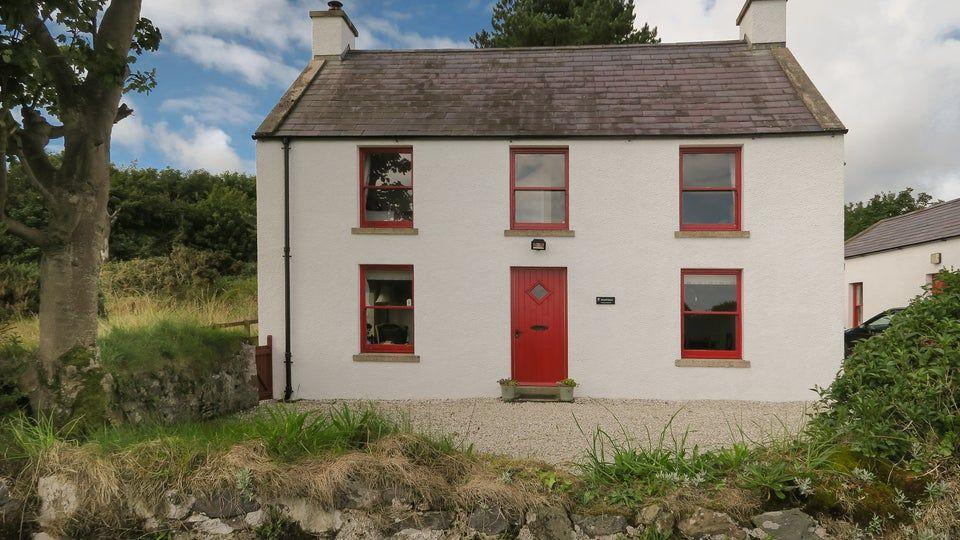 """<p>Sitting on the coast of Antrim Coast & Glens Area of Outstanding Natural Beauty, this Christmas cottage comes with dramatic views. Step inside the festive red front door and you'll discover a quirky layout downstairs, which includes a spacious living room with woodburner, separate dining room and modern kitchen – everything you need for a social family Christmas.</p><p><strong>Be sure to... </strong>Take a relaxing stroll on the sandy beach that curves right past the Christmas cottage. With its secluded setting just north of the village of Cushendun, it's ideal for a Christmas coastal escape with sea views from your bedroom. </p><p><strong>Sleeps:</strong> 5</p><p><strong>Pets:</strong> No</p><p><strong>Price: </strong>£849 for 7 nights over Christmas and New Year (short breaks can be booked one month before for peak periods)</p><p><a class=""""body-btn-link"""" href=""""https://go.redirectingat.com?id=127X1599956&url=https%3A%2F%2Fwww.nationaltrust.org.uk%2Fholidays%2Fstrand-house-northern-ireland&sref=https%3A%2F%2Fwww.countryliving.com%2Fuk%2Ftravel-ideas%2Fstaycation-uk%2Fg33888029%2Fchristmas-cottage%2F"""" target=""""_blank"""">FIND OUT MORE</a></p>"""