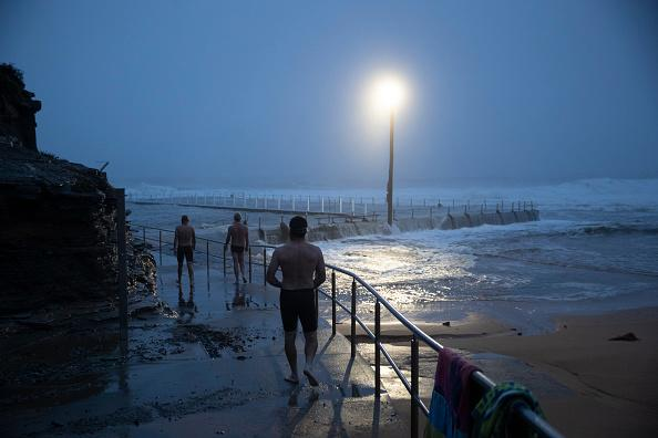 Swimmers brave wild weather at Narrabeen.