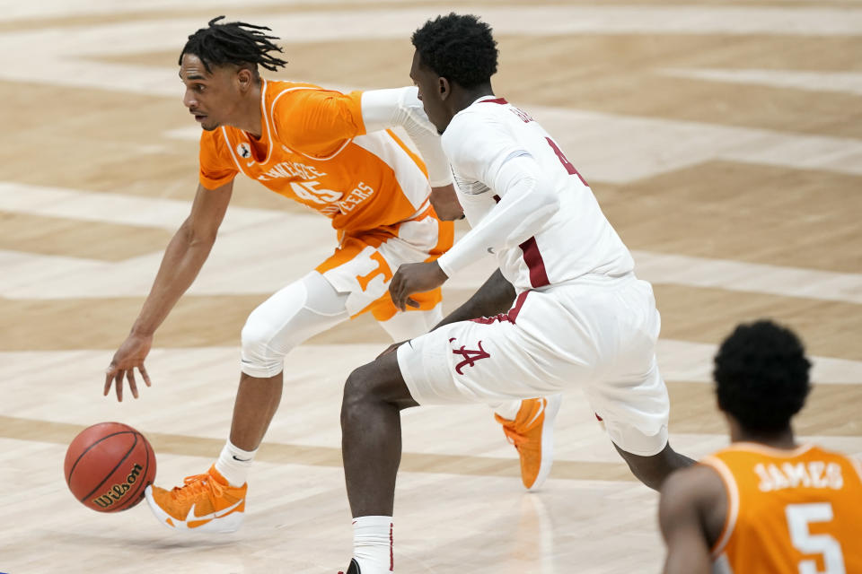 Tennessee's Keon Johnson (45) drives against Alabama's Juwan Gary (4) in the second half of an NCAA college basketball game in the Southeastern Conference Tournament Saturday, March 13, 2021, in Nashville, Tenn. (AP Photo/Mark Humphrey)