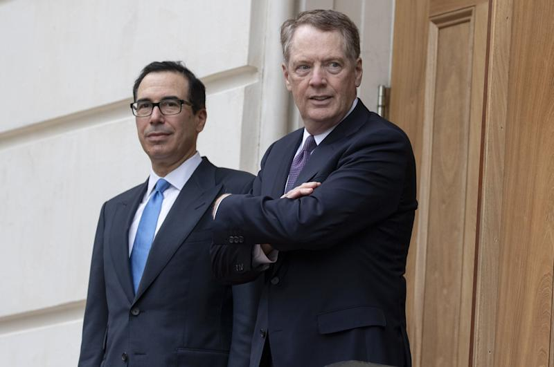 "Robert Lighthizer, U.S. trade representative, right, and Steven Mnuchin, U.S. Treasury secretary, wait to greet Liu He, China's vice premier, not pictured, outside the Office of the U.S. Trade Representative in Washington, D.C., U.S., on Friday May 10, 2019. President Donald Trump boosted tariffs Friday on $200 billion in goods from China and threatened to impose more in his most dramatic steps yet to extract trade concessions, saying there's ""no need to rush"" a deal even though the uncertainty is roiling markets and clouding the global economy. Photographer: Alex Edelman/Bloomberg via Getty Images"