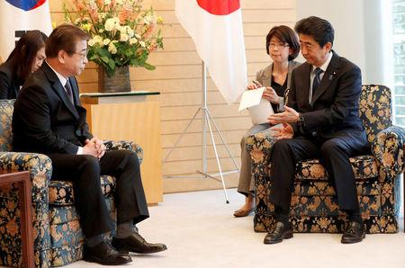 South Korea's National Intelligence Service chief Suh Hoon meets Japan's Prime Minister Shinzo Abe in Tokyo