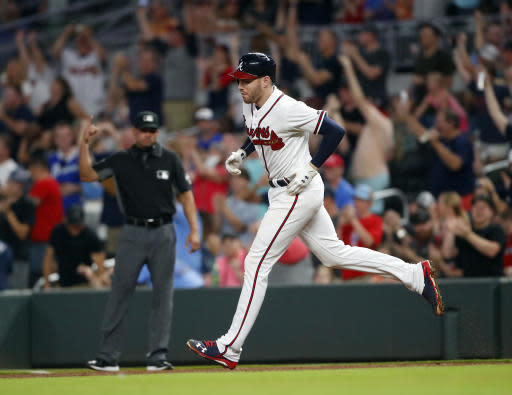 Atlanta Braves' Freddie Freeman (5) rounds first base after hitting a two-run home run in the eighth inning of a baseball game against the Miami Marlins on Saturday, May 19, 2018, in Atlanta. The Braves won 8-1. (AP Photo/John Bazemore)