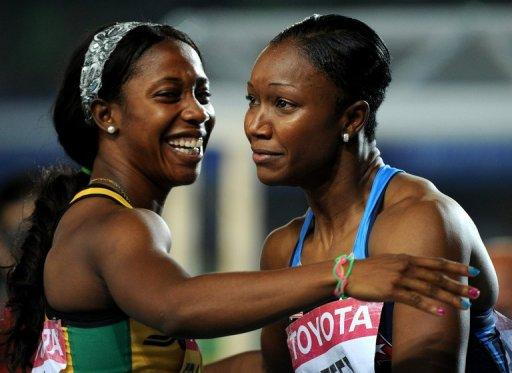 This file photo shows Carmelita Jeter (R) of the US embracing Jamaica's Shelly-Ann Fraser after competing in the women's 100m final at the IAAF World Championships in Daegu, in 2011. Both sprinters are to compete in 100m event at the Olympic Stadium in London, with heats taking place on Friday