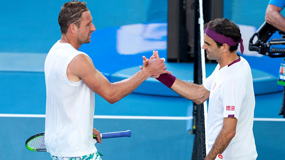 Seen here, Sandgren and Federer at the 2020 Australian Open.