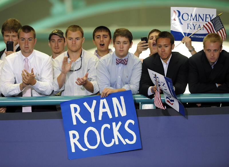"""FILE - In this Monday, Sept. 3, 2012 file photo, supporters cheer for Republican vice presidential candidate, Rep. Paul Ryan, R-Wis., while he speaks at East Carolina University in Greenville, N.C. In 2008, Republican pollster Kristen Soltis says she watched disappointedly as her party """"really let the youth vote go."""" """"This election is such a huge opportunity for Republicans,"""" says Soltis, who, at age 28, is also a member of the millennial generation. But it remains to be seen whether Republicans can win over these young voters on social issues, especially when the economy rebounds. """"Either the party will have to persuade more young people _ or the party will adapt. I don't necessarily know which way that's going to go yet,"""" Soltis says. (AP Photo/Sara D. Davis)"""