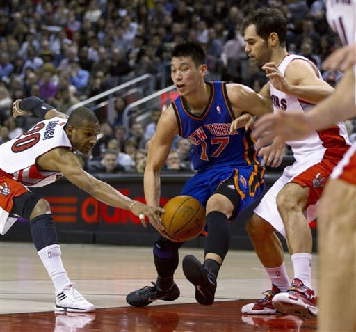 New York Knicks guard Jeremy Lin (17) has the ball stripped as he is double-teamed by Toronto Raptors guards Jose Calderon, right, and Leandro Barbosa during the first half of an NBA basketball game in Toronto on Tuesday, Feb. 14, 2012. (AP Photo/The Canadian Press, Frank Gunn)