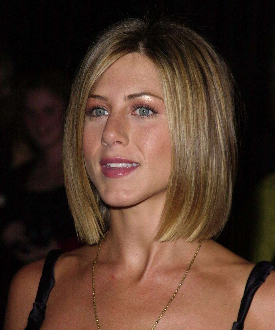 """<h3>2001: Blunt Bob</h3><br>Aniston married Brad Pitt in 2000, and chopped her hair into this blunt, polished <a href=""""https://www.refinery29.com/en-us/2018/08/206672/wedding-haircuts"""" rel=""""nofollow noopener"""" target=""""_blank"""" data-ylk=""""slk:newlywed bob"""" class=""""link rapid-noclick-resp"""">newlywed bob</a> shortly after.<span class=""""copyright"""">Photo: Steve Granitz/WireImage.</span>"""