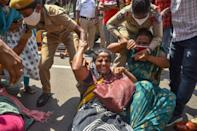 CPI and CPI(M) party workers being detained by the police during a protest against the farm bills, at Sub-Collector's Office in Vijayawada, Friday, Sept. 25, 2020. (PTI Photo)