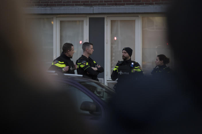 Dutch police stand guard outside a house where the suspect of a shooting incident in a tram was arrested in Utrecht, Netherlands, March 18, 2019. (Photo: Peter Dejong/AP)