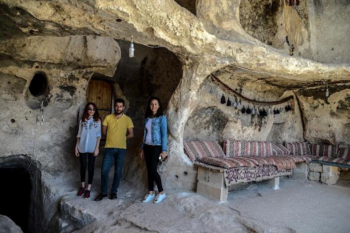 Tourists in the caves at Hasankeyf. Turkish authorities have said they will rehouse residents displaced by the dam project (AFP Photo/ILYAS AKENGIN)