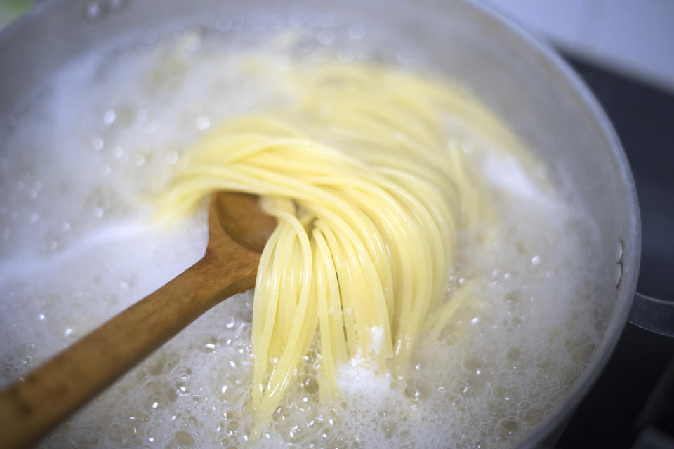 boiled water and spaghetti noodle for cooking italian pasta cuisine