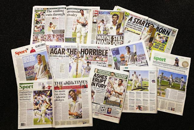 NOTTINGHAM, ENGLAND - JULY 12: A selection of English newspapers covering yesterdays debut innings of 98 runs by Ashton Agar of Australia is seen in the press center during day three of the 1st Investec Ashes Test match between England and Australia at Trent Bridge Cricket Ground on July 12, 2013 in Nottingham, England. (Photo by Ryan Pierse/Getty Images)